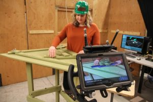 woman assembling a wing in augmented reality